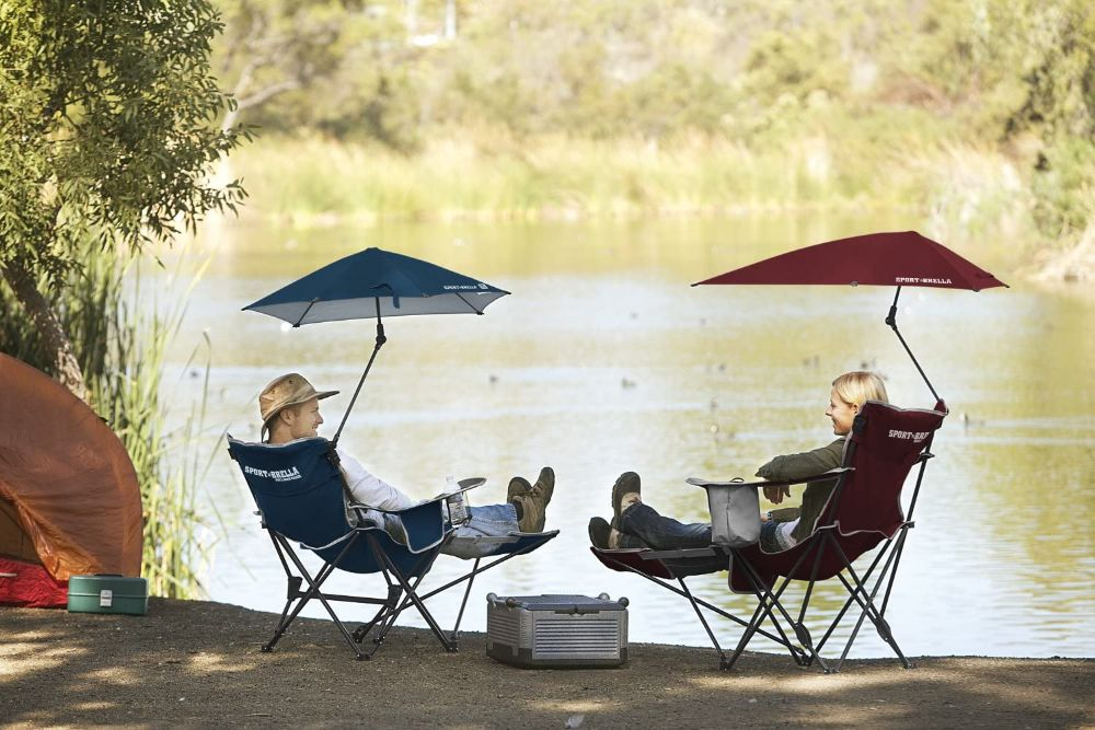 Sport-Brella Recliner Chair with Removable Umbrella and Footrest Next to Water